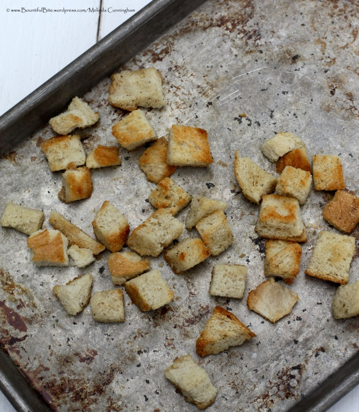 Toasting bread cubes helps dry them for the juicy salad